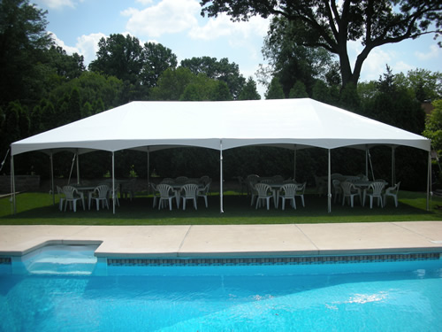 photo of a white tent set up for a backyard party in New Jersey